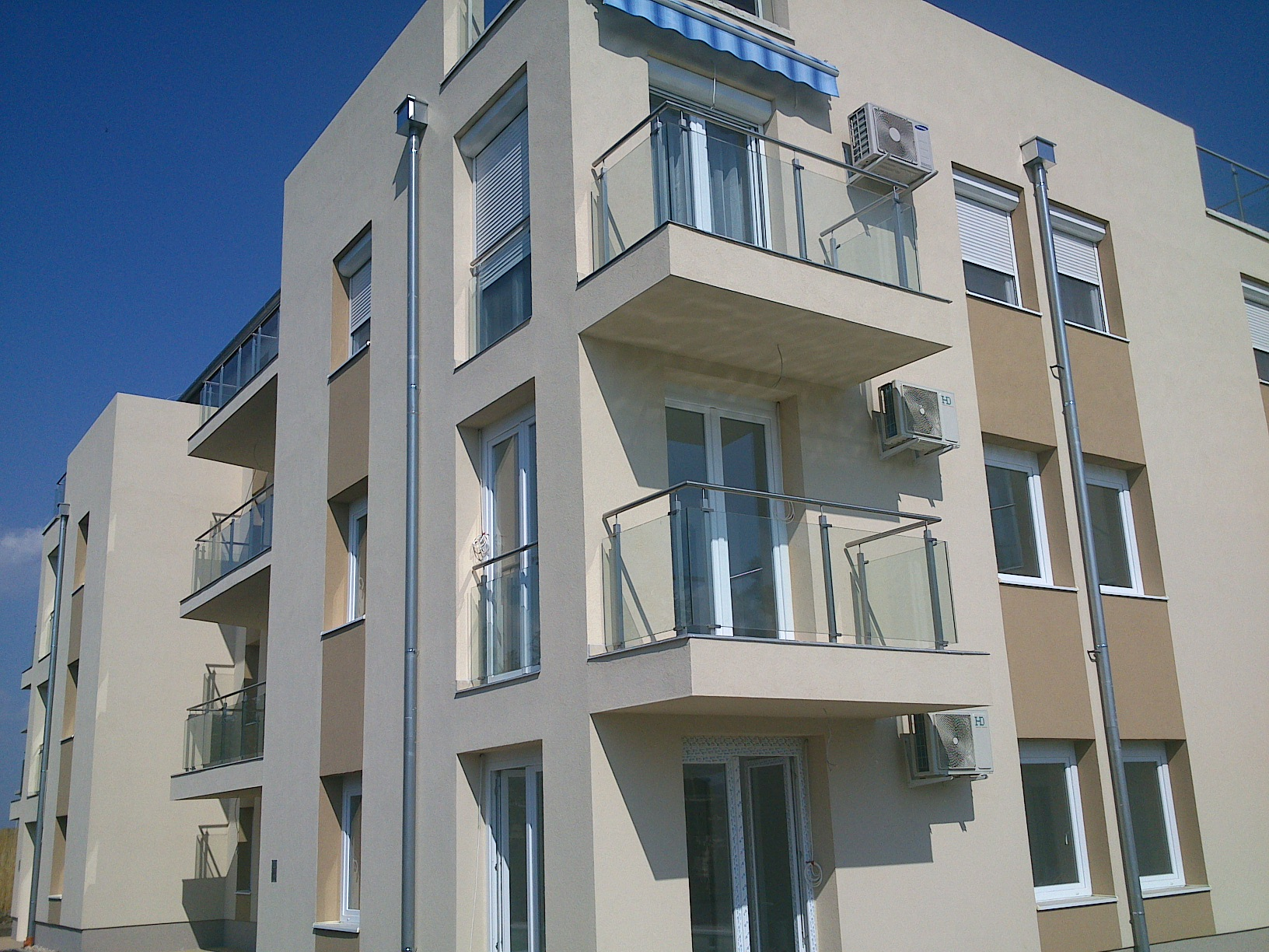 Stainless steel balcony railings with glass inserts